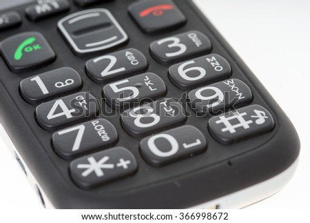 Seniors phone with big buttons on a bright background / Seniors phone