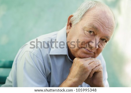 Seniors portrait of contemplative old caucasian man looking at camera. Copy space