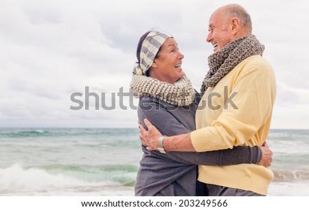 seniors relaxing smiling laughing colder season - stock photo