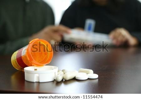 Seniors taking pills - stock photo
