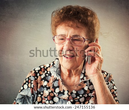 Seniors talking mobile phone. Old adult mature woman  - stock photo