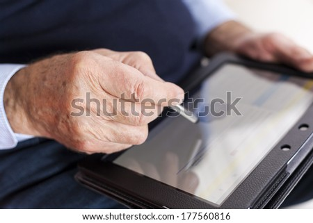 seniors using tablet and smart phone