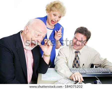 Seniors with their accountant, excited about getting a big tax refund.  White background - stock photo
