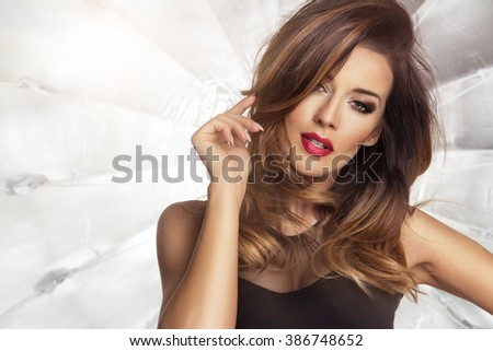 Sensual beautiful brunette woman posing in dress. Girl with long curly hair.  - stock photo