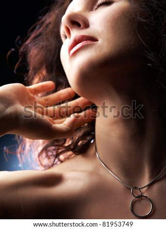 sensual beautiful woman touches her fingers to the neck - stock photo