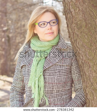 Sensual Beautiful Young Woman with glasses portrait in nature. Caucasian female autumn winter season clothing  outdoor. - stock photo
