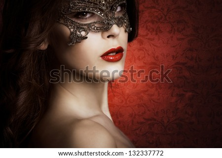sensual beautiful young woman with lace mask, studio shot - stock photo