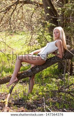 Sensual blond model in sexy outfit outdoor - stock photo