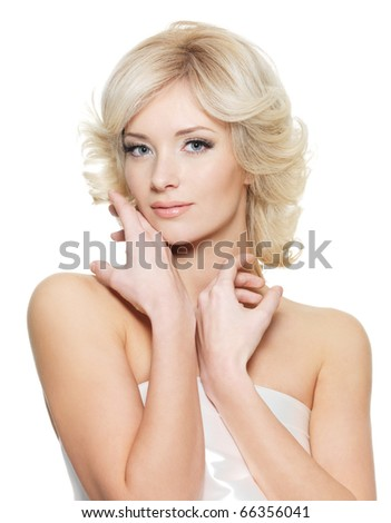 Sensual blond woman with fresh health skin posing on white background - stock photo