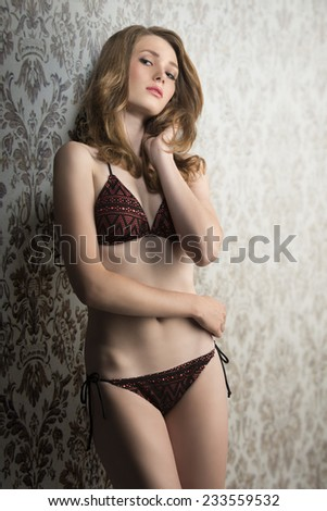 sensual blonde girl with fashion bikini and perfect body posing in glamour portrait  - stock photo
