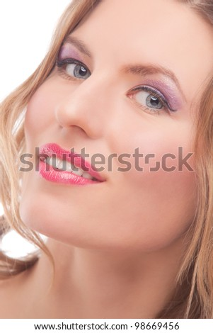 sensual blonde woman with bright makeup smiling over white background