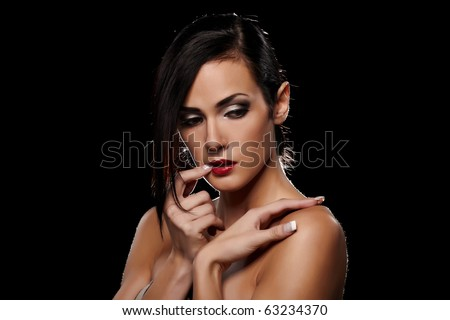Sensual brunette lady portrait on black background