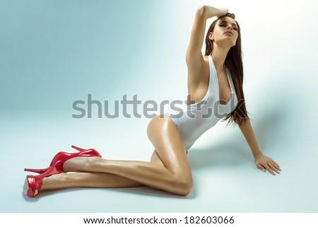 Sensual brunette posing - stock photo