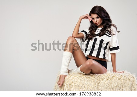 Sensual brunette woman wearing fashionable lingerie, posing, looking at camera.  - stock photo