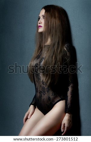 Sensual brunette woman with long hair posing in underwear - stock photo