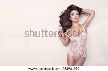 Sensual brunette woman with perfect body posing in lingerie . - stock photo