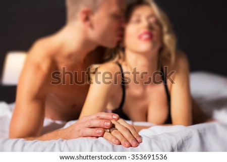 Sensual couple in bedroom  - stock photo