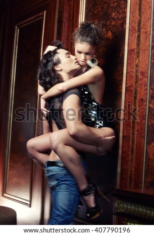 Sensual couple posing in modern room.