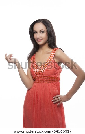 sensual dark hair caucasian girl in peachy designer's dress with lifted hand isolated over pure white background