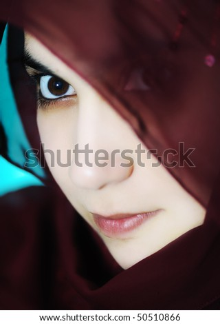 Sensual eastern, asian, arabic woman, glamor under the scarf - stock photo