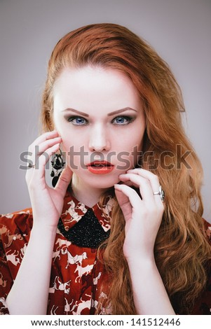 Sensual fashion portrait of redhead vamp girl with long hair