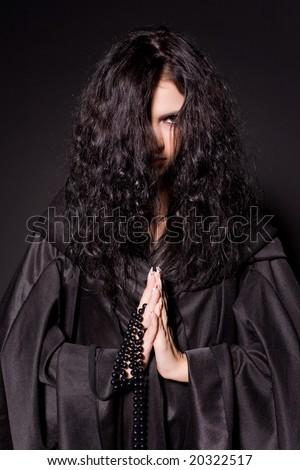 Sensual girl in nun outfit, praying - stock photo