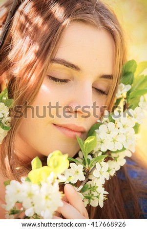 sensual girl portrait in cherry flowers