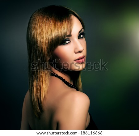Sensual girl with beautiful makeup on black background