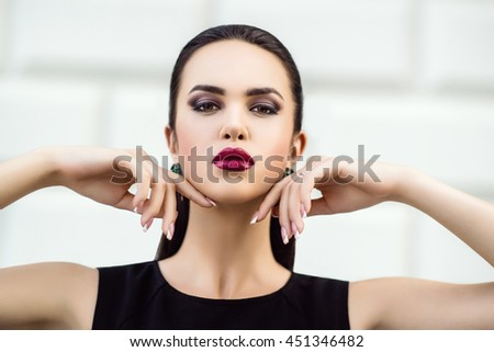 Sensual glamour portrait of beautiful woman model lady with bright makeup with red lips color and clean healthy skin face. Fashion photo, outdoor. - stock photo
