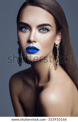 sensual glamour portrait of beautiful  woman model lady with colorful makeup with blue lips  and jewelry - stock photo