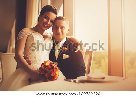 sensual happy married couple in restaurant
