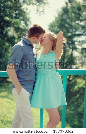 Sensual kiss, couple in love enjoying each other in city - stock photo