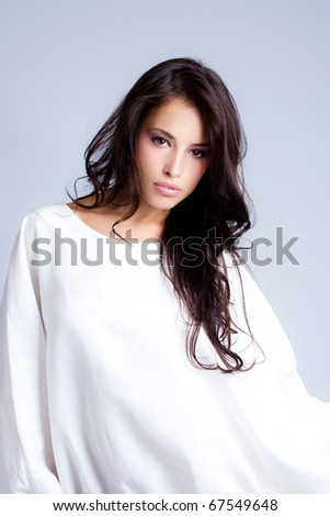 sensual longhair brunette in white, studio shot