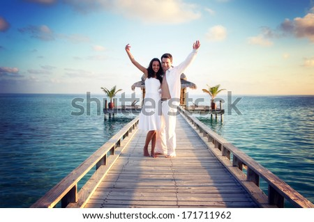 Sensual love couple on a jetty on Maldives - stock photo