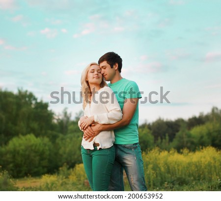 Sensual lovely couple outdoors - stock photo