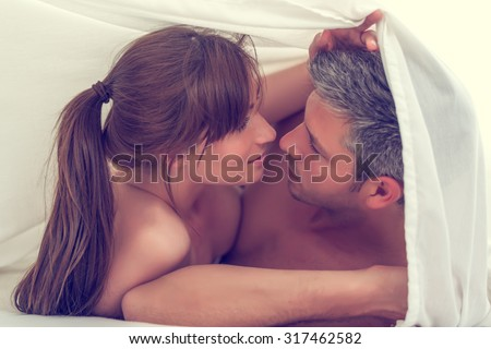 sensual lovers in bed making love - stock photo