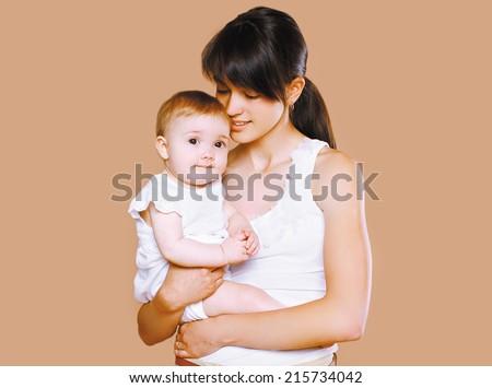 Sensual mom and baby - stock photo