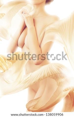 sensual naked woman in yellow textile on white background - stock photo