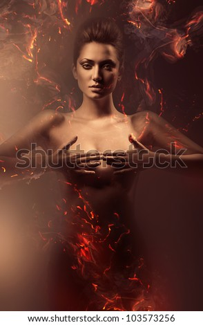 sensual nude woman in fire - stock photo