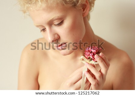 Sensual nudes young woman with dry rose in the hands. - stock photo