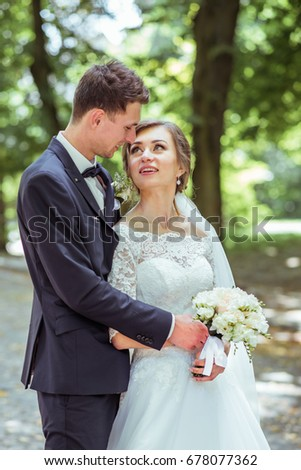 Sensual portrait of a wedding young couple. Wedding photo outdoor