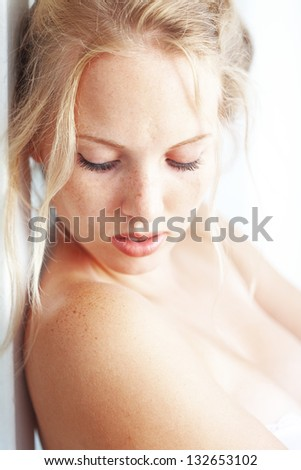 Sensual portrait of beautiful young blond woman - stock photo