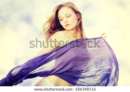 Sensual portrait of young beautiful caucasian woman dancing with wind. - stock photo