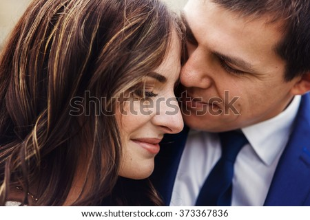 Sensual romantic newlywed couple, hugging, face closeup - stock photo