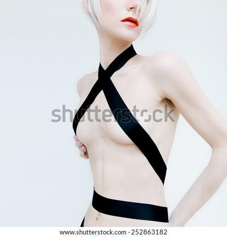 Sensual Sexy blond Model in black satin ribbon - stock photo