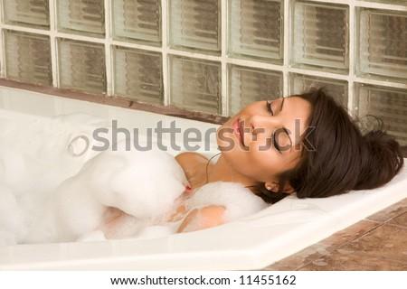 Sensual sexy woman relaxing in bath foam - stock photo