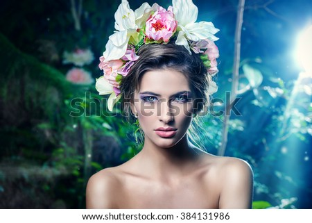 Sensual spring lady in a wreath of flowers. Beauty, cosmetics. Make-up. - stock photo