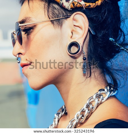 Sensual Teen Girl with piercing and fashionable hairstyle - stock photo