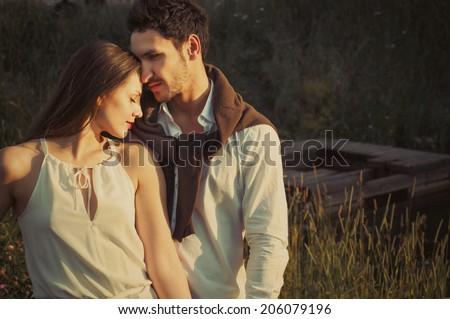 sensual tender vintage style couple enjoying sun  - stock photo