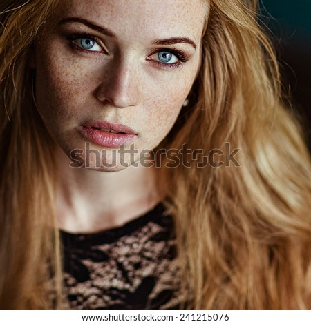 Sensual very beautiful redhead girl with freckles, close up - stock photo
